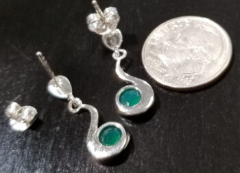 back of green onyx and sterling silver post earrings with dime for scale