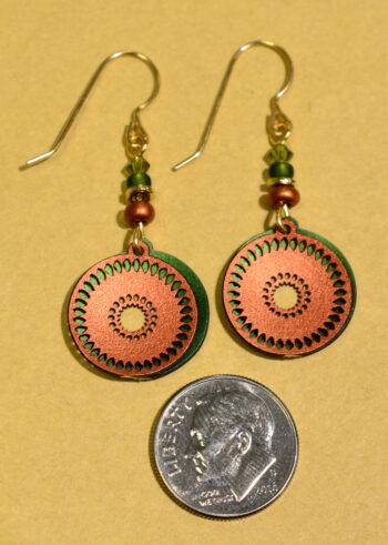 back of green and orange circle Adajio earrings with dime
