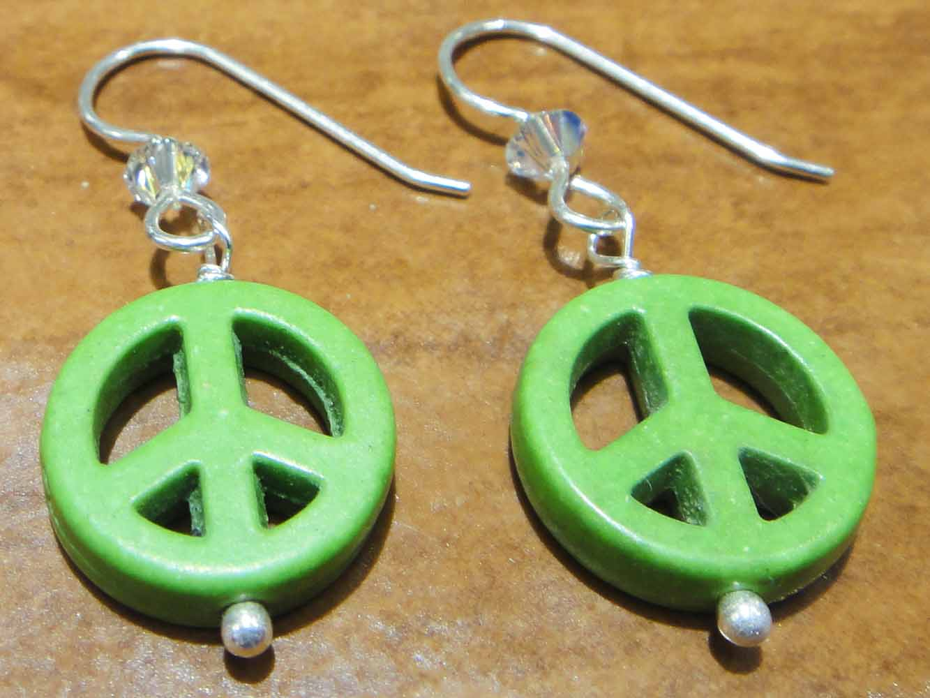 handmade green peace sign, swarovski crystal, and sterling silver earrings