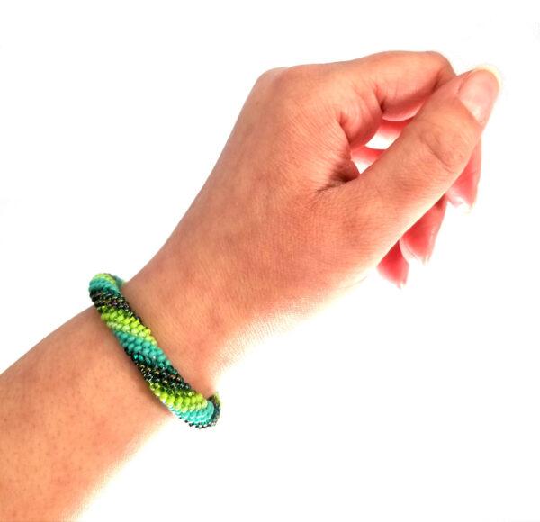 Czech glass green bracelet on hand