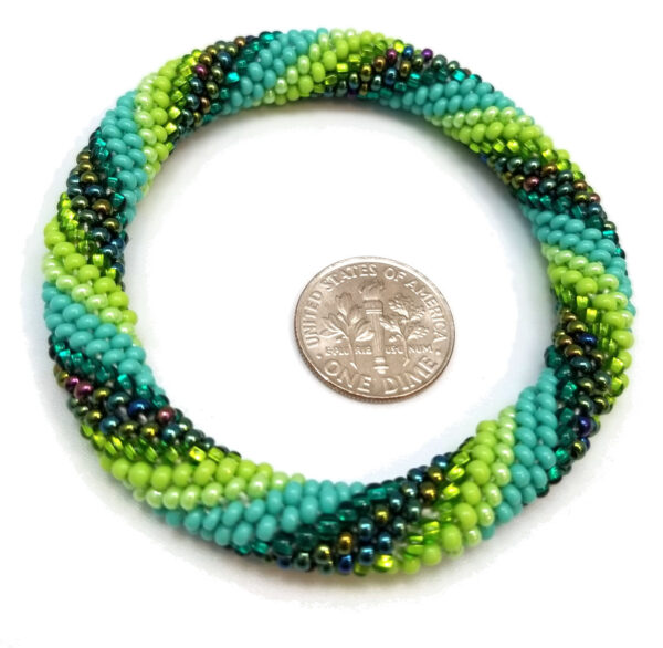 green striped Czech glass woven seed bead bracelet with dime to help you judge scale