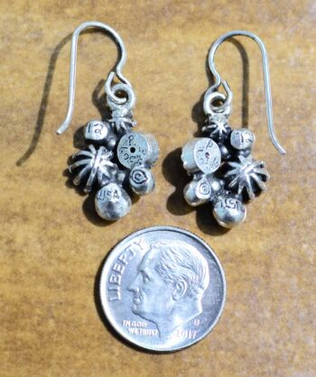 back of Hana silver tone earrings by Patricia Locke with dime or size