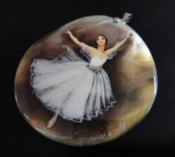 This hand painted ballerina pendant is designed by Anna King