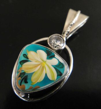 This mother of pearl pendant was hand painted in Russia.