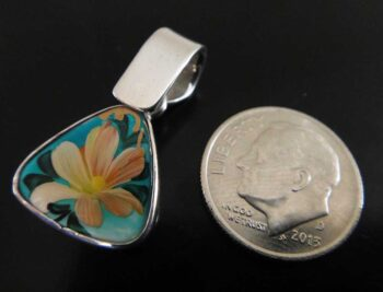 hand painted flower pendant with dime for scale