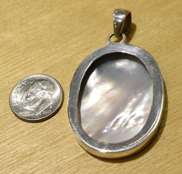 back of hand painted tiger mother and cubs pendant with dime for scale