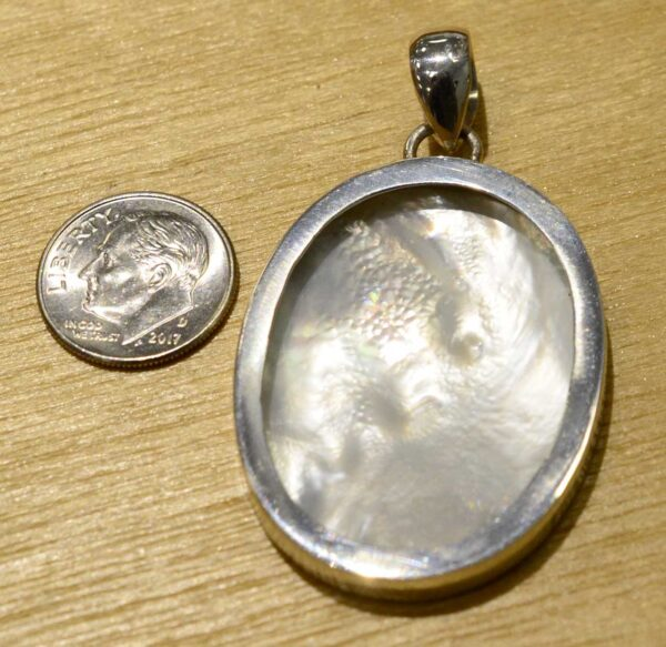 back of hand painted zebra mother and colt pendant with dime for scale