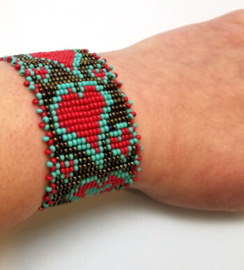 woven heart seed bead bracelet on wrist