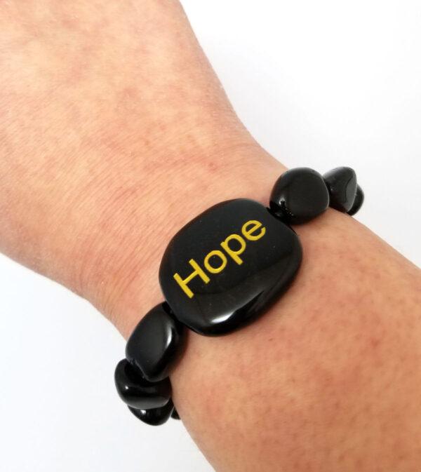 hope bracelet on wrist