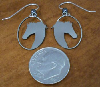 Back of silver-tone horse head earrings handmade by Sienna Sky pictured with dime for scale