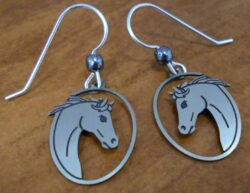 These silver-tone horse head earrings are handmade by Sienna Sky.