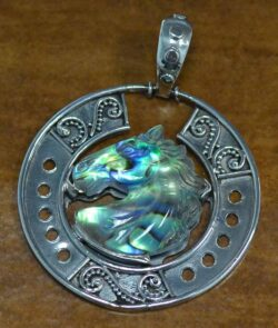 This quartz and paua shell horse head pendant is made by Anna King.