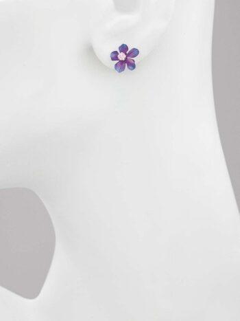 Purple plumeria post earrings on stand