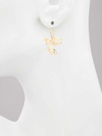 hummingbird earrings on model for scale