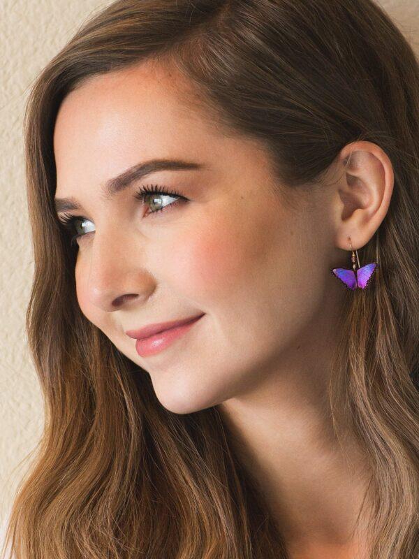 magenta butterfly earrings on model