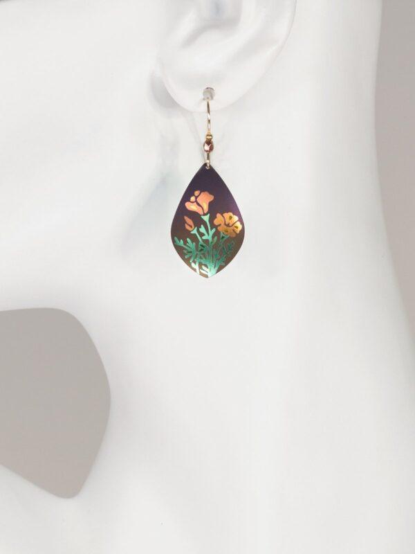 poppy flower earrings on mannequin
