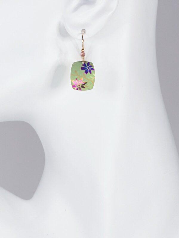 bright green flower meadow earrings on mannequin