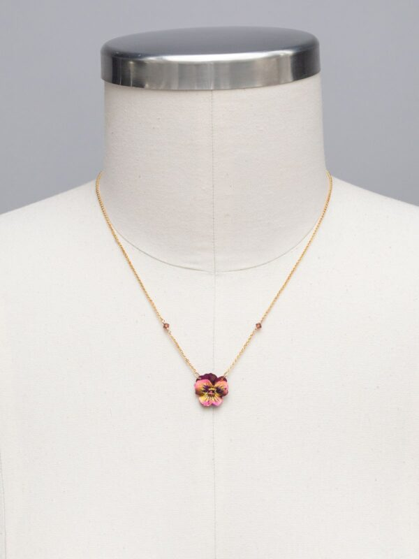 Holly Yashi flower necklace on mannequin to help you gauge size