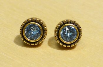 These stud earrings are handmade by Patricia Locke Jewelry. Patricia Locke names each style and this earring style is named Indie. These earrings feature Patricia Locke's light blue colored crystal called Aqua.