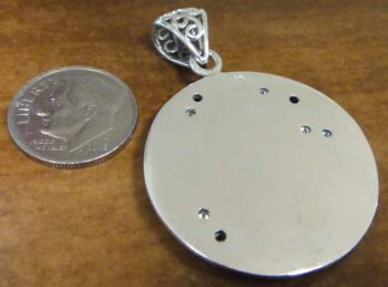 back of iolite and CZ sterling silver cat pendant with dime for scale