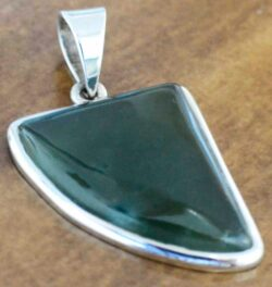 Green jade abstract tooth shaped pendant