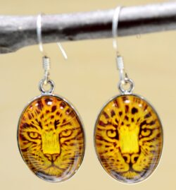 Handmade carved amber jaguar and sterling silver earrings