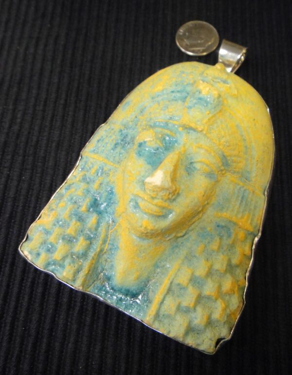 King Tutankhamun bust and sterling silver pendant with dime for size