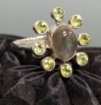 side view of labradorite, peridot, and sterling silver ring