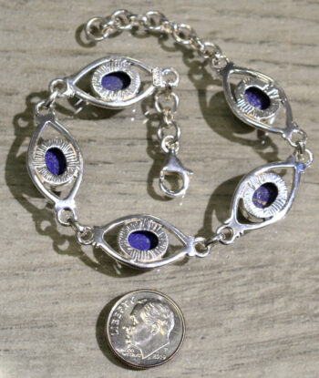 back of handmade blue lapis lazuli bracelet with dime for scale