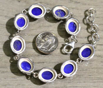 back of lapis lazuli and sterling silver bracelet with dime for scale