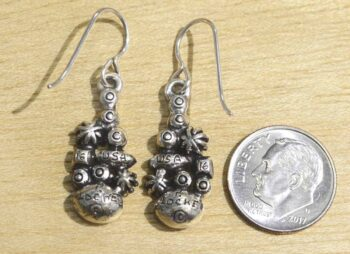back of Lara earrings by Patricia Locke with dime for size