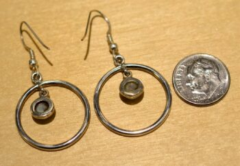 Back view of larimar and sterling silver circle dangle earrings shown with dime (not included) for scale