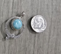Larimar pendant with dime for scale