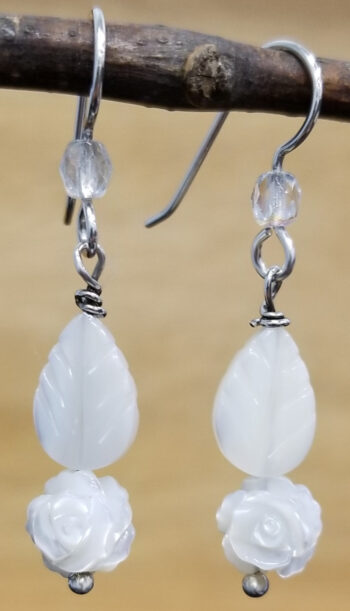 carved white mother of pearl rose with leaf and sterling silver earrings
