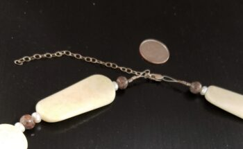 lemon and brown jasper necklace with dime for scale by clasp