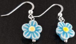 light blue ceramic daisy earrings
