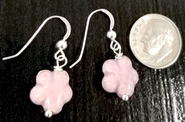 back of light purple daisy earrings with dime for scale