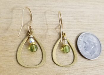 back of lime green earrings with dime for scale
