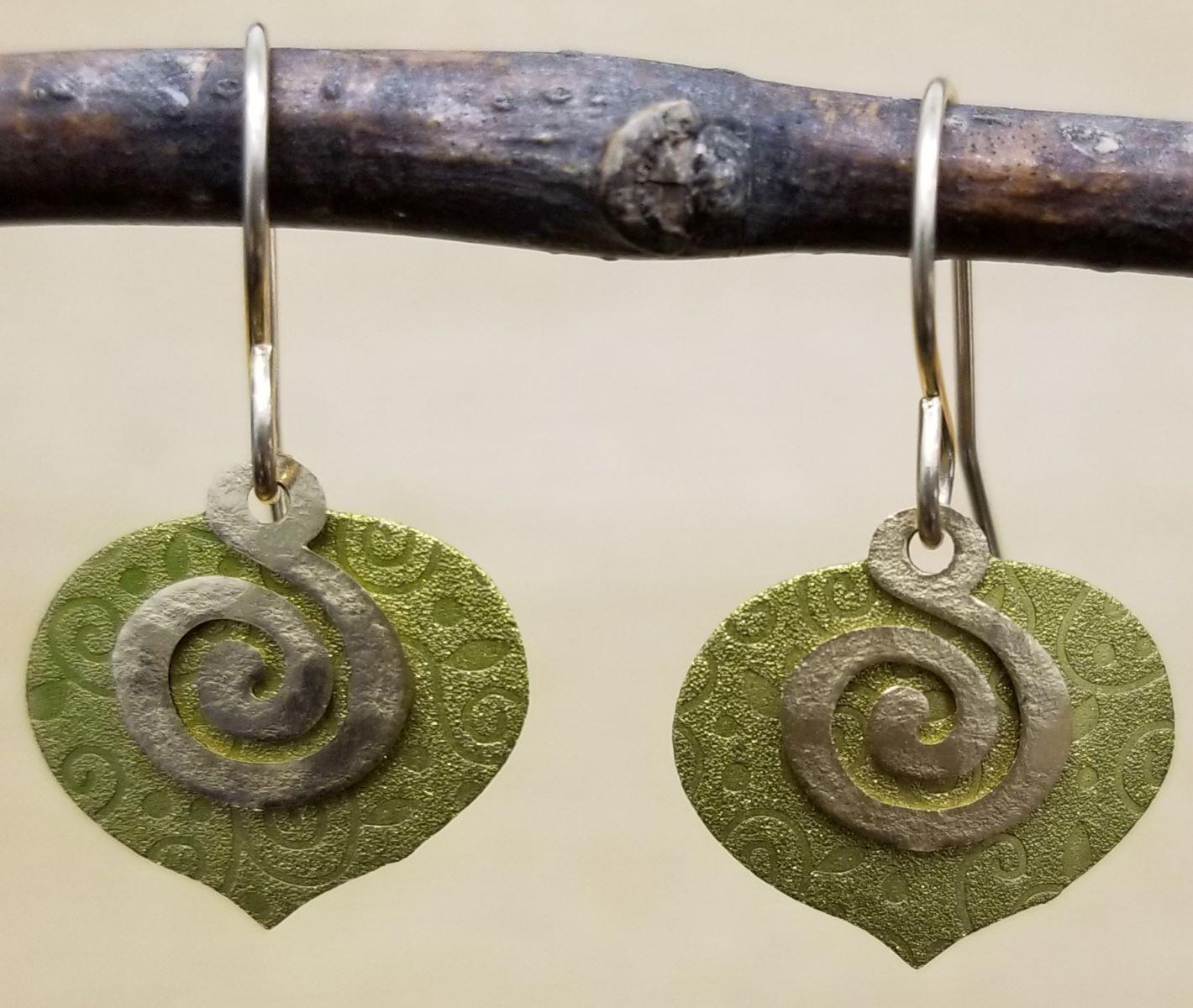 swirl earrings by Joseph Brinton