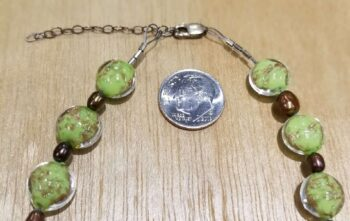 close up of necklace clasp with dime for scale