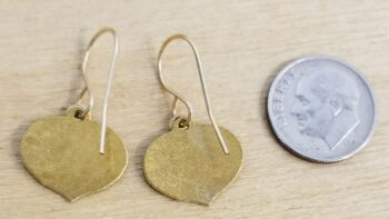 back of Joseph Brinton earrings with dime for scale
