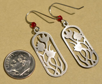 back of sienna sky red flower dangle earrings with dime