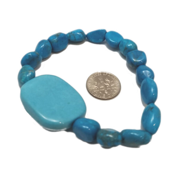 back of luck bracelet with dime to help gauge scale
