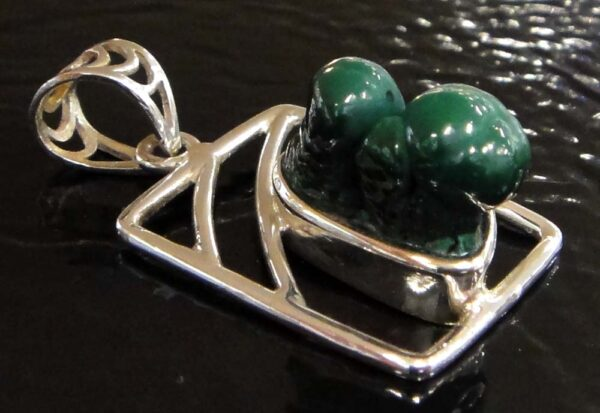 Green malachite and sterling silver pendant close up