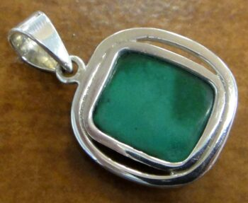 Raw green malachite and silver pendant back