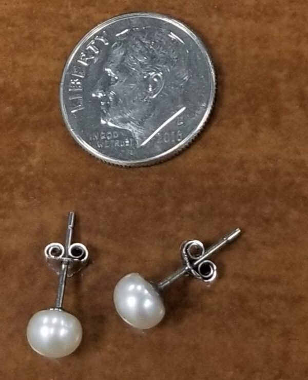 medium pearl stud with dime for scale