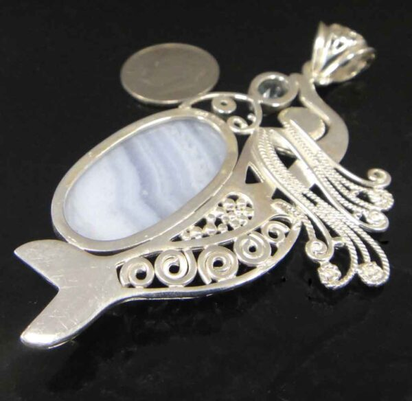 back of blue lace agate and blue topaz sterling silver mermaid pendant with dime for scale