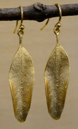 These earrings feature a eucalyptus leaf on each earring.