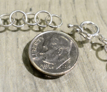 clasp of butterfly wing bracelet with dime