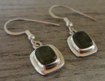 Green moldavite and sterling silver dangle earrings close up